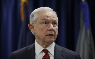 """FILE - In this July 21, 2017 file photo, Attorney General Jeff Sessions speaks in Philadelphia. President Donald Trump took a new swipe at on Monday, July 24, 2017, referring to him in a tweet as """"beleaguered"""" and wondering why Sessions isn't digging into Hillary Clinton's alleged contacts with Russia. (AP Photo/Matt Rourke, File)"""