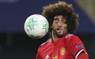 Crash test. Κανονική σύγκρουση ήταν αυτή της μπάλας με το κεφάλι του Marouane Fellaini με τα αποτελέσματα όπως φαίνονται στην εικόνα. Το στιγμιότυπο είναι από τον αγώνα του UEFA Super Cup μεταξύ της Manchester United και της Real Madrid.  AP Photo/Boris Grdanoski