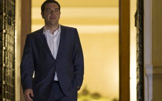Greek Prime Minister Alexis Tsipras leaves the Maximos Mansion after a governmental council in Athens, Greece June 27, 2015. Greek Prime Minister Alexis Tsipras called a referendum on bailout demands from foreign creditors on Saturday, rejecting an