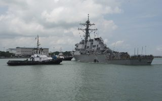 In this Aug. 21, 2017, photo provided by U.S. Navy, tugboats from Singapore assist the Guided-missile destroyer USS John S. McCain (DDG 56) as it steers towards Changi Naval Base, Singapore following a collision with the merchant vessel Alnic MC while underway east of the Straits of Malacca and Singapore. The U.S. Navy ordered a broad investigation into the performance and readiness of the Pacific-based 7th Fleet after the USS John S. McCain collided with an oil tanker in Southeast Asia. (Mass Communication Specialist 2nd Class Joshua Fulton/U.S. Navy via AP)