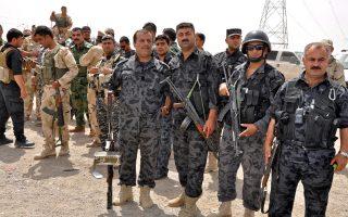 Πεσμεργκά (Κούρδοι μαχητές) υπερασπίζονται το Κιρκούκ από επίθεση του Ισλαμικού Κράτους το 2014.