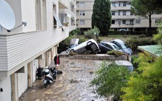 epa06195737 Cars that were taken with by floods sit in a ground floor in Livorno, Italy, 10 September 2017. According to reports, five people were found dead in a flooded basement after abundant rain.  EPA/ALESSIO NOVI BEST QUALITY AVAILABLE