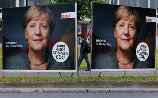 «Επιτυχημένη για τη Γερμανία» είναι το σύνθημα στην αφίσα της Αγκελα Μέρκελ.