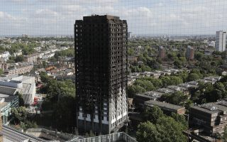 The scorched facade of the Grenfell Tower in London, Thursday, June 15, 2017, after a massive fire raced through the 24-storey high-rise apartment building in west London early Wednesday.  Firefighters are beginning the task of combing through the devastated apartment tower, Thursday, checking integrity of the structure and searching to find victims. (AP Photo/Frank Augstein)