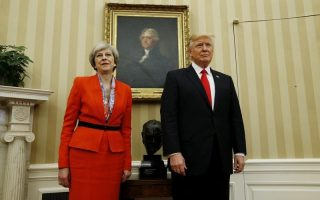 British Prime Minister Theresa May and U.S. President Donald Trump stand side by side at the start of a meeting in the Oval Office of the White House in Washington January 27, 2017.  REUTERS/Kevin Lamarque