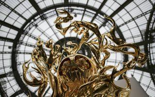 Φλόγες του πόθου. Ξεκίνησε η FIAC, η διεθνής έκθεση σύγχρονης τέχνης του Παρισιού στο Grand Palais. Τα εκθέματα πολλά και εντυπωσιακά, ανάμεσα σε αυτά και το εικονιζόμενο ¨'Flame of Desire - Gold¨του Γιαπωνέζου καλλιτέχνη Takashi Murakami.  EPA/IAN LANGSDON