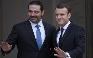 epaselect epa06336762 French President Emmanuel Macron (R) greets Lebanese Prime Minister Saad Hariri (R) upon his arrival at the Elysee Palace in Paris, France, 18 November 2017. Hariri, who announced on 04 November his resignation and remained since then in the Saudi capital, has arrived in France on 18 November for his meeting with French President Emmanuel Macron at the Elysee Palace.  EPA/YOAN VALAT