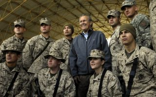A Photo released by the US Departmet of Defence shows outgoing US Secretary of Defence Donald Rumsfeld posing with troops assigned to Al-Asad Air Base in Iraq's restive Al-Anbar province during a surprise visit to Iraq, 09 December 2006. Rumsfeld made a surprise farewell visit to Iraq, urging American troops to stay the course in the face of a critical US report about the conduct of the war. Rumsfeld, who resigned in November in the wake of the Republican Party's defeat in congressional polls that has been largely blamed on US war policy, visited two US bases, according to the Pentagon website. AFP PHOTO/DOD/CHERIE A. THURLBY