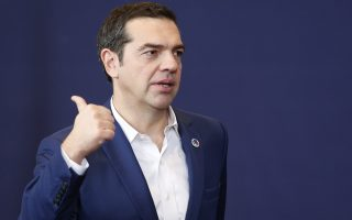 epa06347930 Greece Prime Minister Alexis Tsipras leaves the familly picture at the EU Eastern Partnership (EaP) Summit in Brussels, Belgium, 24 November 2017. The summit brings together EU heads of states or government with six former Soviet states Armenia, Azerbaijan, Belarus, Georgia, Moldova and Ukraine.  EPA/JULIEN WARNAND