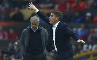 Celta's head coach Eduardo Berizzo , right, gestures towards his players as Manchester United's manager Jose Mourinho looks down during the Europa League semifinal second leg soccer match between Manchester United and Celta Vigo at Old Trafford in Manchester, England, Thursday, May 11, 2017. (AP Photo/Dave Thompson)