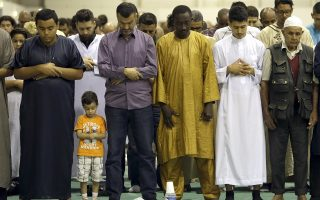 FILE - In this Sept. 12, 2016 file photo muslims offer Eid al-Adha prayers in a convention center in Marseille, southern France. A new study on Europe's Muslim population suggests that even if all migration into the continent were to stop permanently, the group's share would still be expected to increase to 7.4 percent from the current level of 4.9 percent by 2050. Thursday's, Nov. 30, 2017 report by the Pew Research Center modeled three scenarios on Europe's future Muslim population that vary depending on future levels of migration. (AP Photo/Claude Paris)