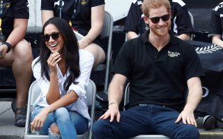FILE PHOTO: Britain's Prince Harry and his girlfriend actress Meghan Markle watch the wheelchair tennis event during the Invictus Games in Toronto, Ontario, Canada September 25, 2017.   REUTERS/Mark Blinch/File Photo