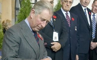 Britain's Prince Charles signs the guest book, at Canada's Royal Agricultural Winter Fair in Toronto in this file photo taken November 6, 2009.Britain's Supreme Court ruled on Thursday that 27 letters written by Prince Charles to ministers in 2004-2005 can be disclosed to the media, a step that could cast doubt over the political neutrality of the future king.  REUTERS/Fred Thornhill TPX IMAGES OF THE DAY