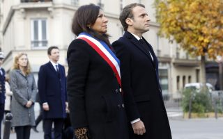 French President Emmanuel Macron and Paris mayor Anne Hidalgo, left, stand in front of a commemorative plaque facing the 'Le Carillon' bar and 'Le Petit Cambodge' restaurant during a ceremony marking the second anniversary of the Paris attacks, Monday Nov.13 2017. Macron, Paris Mayor Anne Hidalgo and victims' families are paying homage to 130 people killed two years ago when Islamic State extremists attacked the City of Light. (Etienne Laurent, Pool via AP)