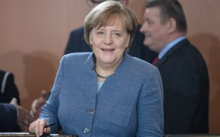 epa06343490 German Chancellor Angela Merkel of the Christian Democratic Union (CDU) arrives for the beginning of the weekly meeting of the German Federal cabinet at the Chancellery in Berlin, Germany, 22 November 2017. During the 166th cabinet meeting, the acting ministers and the acting Chancellor are expected to discuss, among others, the Pension Insurance Report 2017.  EPA/CLEMENS BILAN