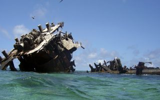 In this photo released by the PEW environment group shows a shipwreck at Bougainville Reef in this undated photo in the Coral Sea. An alliance of environmentalists, marine scientists and former navy officials on Wednesday, Sept. 10, 2008, asked the Australian government to establish a vast conservation area in the Coral Sea in order to protect not only marine animals and reefs but World War II history. The Pew Environment Group partnered with marine scientists and two former Australian Navy chiefs on the proposal for a 400,000 square mile (1 million square kilometer) Coral Sea Heritage Park, of the Great Barrier Reef, on Australia's northeastern coast, and would extend to the country's maritime boundaries with Papua New Guinea, the Solomon Islands and New Caledonia. (AP Photo/Undersea Explorer,HO) **EDITORIAL USE ONLY**
