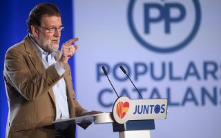 epa06324431 Mariano Rajoy, Spanish Prime Minister and ruling People's Party (PP)'s President, delivers a speech during the presentation of PP's candidate for Catalonian regional President, Xavier Garcia Albiol (unseen), in Barcelona, northeastern Spain, 12 November 2017. The Catalonian regional election will be held on 21 December 2017.  EPA/MARTA PEREZ