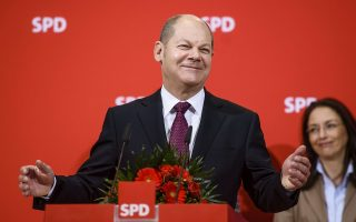 Hamburg's mayor Olaf Scholz of the Social Democrats party (SPD) holds a speech during a press conference on February 16, 2015 in Berlin a day after regional elections in Hamburg. Merkel's conservative CDU party scored its worst-ever result in the northern port city poll, a traditional stronghold of the centre-left Social Democrats (SPD). Anti-Euro party AFD (Alternative for Germany) scored about six percent and entered the parliament of the City-State.