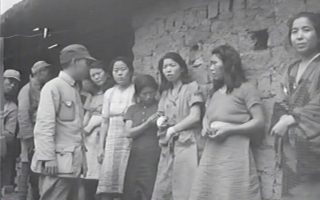 epa06078706 An undated handout made available on 10 July 2017 by the Seoul Metropolitan Government and the Seoul National University Human Right Center shows a video grab of what is believed to be the first footage of 'comfort women' lining up in front of soldiers during World War II. The short video clip was reportedly taken by US military in China and was found by the Seoul National University Human Right Center researchers in the US military archives. Some 200,000 Asian women, mostly Koreans, forcibly served as sex slaves, euphemistically called 'comfort women,' for the Japanese army during World War II.  EPA/SEOUL METROPOLITAN GOVERNMENT HANDOUT BEST QUALITY AVAILABLE HANDOUT EDITORIAL USE ONLY/NO SALES