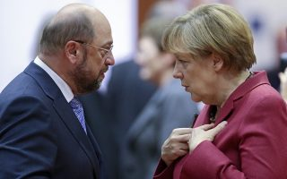 epa05759362 (FILE) - A file picture dated 23 October 2014 shows German Chancellor Angela Merkel (R) and the President of the European Parliament, Martin Schulz (L) talk prior to the start of the EU Summit at the EU Council headquaters in Brussels, Belgium. Schulz on 29 January 2017 was officially nominated by the Social Democrats (SPD) party chair as SPD's as top candidate to take on Chancellor Merkel in German general elections in September 2017. He is scheduled to be elected as party chairman during a extraordinary party confention in March.  EPA/OLIVIER HOSLET *** Local Caption *** 51631647