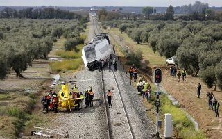 A train carriage is seen derailed near the town of Arahal, in the Seville province, Spain, Wednesday, Nov. 29, 2017. Spanish officials said 27 people were injured Wednesday when a train carriage derailed after part of a track became flooded between the southern cities of Malaga and Seville. (AP Photo/Toni Rodriguez)
