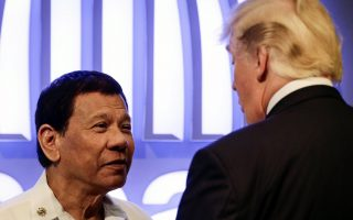 epaselect epa06325815 Philippine President Rodrigo Duterte (L) talks to US President Donald J. Trump (R) before the opening ceremony of the 31st ASEAN Summit in Manila, Philippines,13 November 2017. The Philippines is hosting the 31st Association of Southeast Asian Nations (ASEAN) Summit and Related Meetings from 10 to 14 November.  EPA/MARK R. CRISTINO / POOL