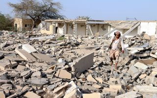 epa06383438 An armed member of Yemen's Saudi-backed forces inspects a destroyed building at a strategic town after seizing it from the Houthi rebels in the western province of Hodeidah, Yemen, 11 December 2017. According to reports, Yemeni army forces and the Popular Resistance militiamen, with the air support by the Saudi-led military coalition, have made rapid advances in recent days in Hodeidah province, on Yemen's Red Sea coast, beginning with the capture of Al-Khokha following fierce battles with the Houthis.  EPA/STRINGER