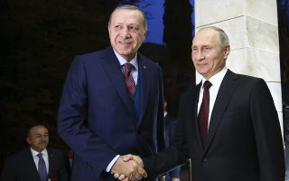 Russian President Vladimir Putin, right, shakes hands with Turkish President Recep Tayyip Erdogan, left, as he welcomes him prior to their meeting in the Bocharov Ruchei residence in the Black Sea resort of Sochi, Russia, Monday, Nov. 13, 2017. Putin is hosting Turkish counterpart Recep Tayyip Erdogan for talks focusing on the situation in Syria. (Kayhan Ozer, Pool Photo via AP)