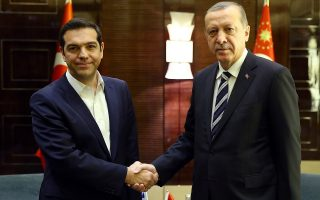 Turkey's President Recep Tayyip Erdogan, right, shakes hands with Greek Prime Minister Alexis Tsipras prior to their meeting on the sidelines of the Belt and Road Forum in Beijing, Saturday, May 13, 2017. (Press Presidency Press Service via AP, Pool)