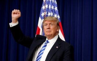 FILE PHOTO: U.S. President Donald Trump pumps his fist as he departs after attending a CEO town hall on the American business climate at the Eisenhower Executive Office Building in Washington, U.S., April 4, 2017. REUTERS/Kevin Lamarque/File Photo