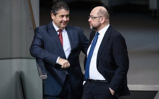 epa06384630 German Foreign Minister Sigmar Gabriel (L) of the Social Democratic Party (SPD) and the leader of the Social Democratic Party (SPD), Martin Schulz (R), talk during a session of the German parliament 'Bundestag' in Berlin, Germany, 12 December 2017. The heads of the Social Democrats and the Christian Democrats are about to meet on 13 December 2017 for exploratory talks in Berlin.  EPA/CLEMENS BILAN