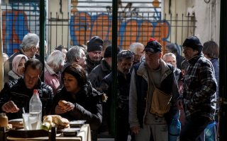 People line up as they wait to enter a soup kitchen run by the Orthodox church in Athens, Greece, February 15, 2017. REUTERS/Alkis Konstantinidis