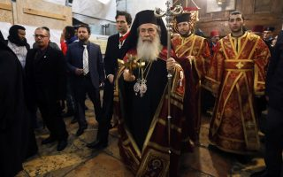 epa06420198 Jerusalem's Greek Orthodox patriarch Theophilos III (C) attends a Christmas service according to the Eastern Orthodox calendar, at the church of Nativity in the West Bank town of Bethlehem, 06 January 2018. The Church of the Nativity, built on the site where Jesus Christ is believed to have been born in the West Bank city of Bethlehem, is administered jointly by Greek Orthodox, Roman Catholic, Armenian Apostolic, and Syriac Orthodox church. Protests were held during the Patriarch's visit to the church against the alleged sale of lands by the Greek Orthodox Church to Israelis.  EPA/ABED AL HASHLAMOUN