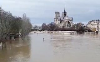 A view shows the flooded banks of the Seine River and Notre Dame cathedral after days of rainy weather in Paris, France January 24, 2018 in this still image taken from a video obtained from social media. COURTESY of TWITTER/@MICHBES /via REUTERS THIS IMAGE HAS BEEN SUPPLIED BY A THIRD PARTY. MANDATORY CREDIT. NO RESALES. NO ARCHIVES