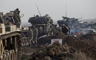 epa06463946 Turkish soldiers prepare their tanks before crossing the Syrian-Turkish border, at the Hassa district on the Turkish-Syrian border in Hatay, Turkey, 22 January 2018. According to media reports, the Turkish army is preparing to conduct an operation (named 'Operation Olive Branch') in Syria's northern regions against the Kurdish Popular Protection Units (YPG) forces which control the city of Afrin. According to YPG media channels, bombings by the Turkish military killed at least 10 people earlier on the same day. Turkey classifies the YPG as a terrorist organization.  EPA/SEDAT SUNA