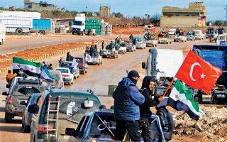 Αυτοκινητοπομπή μαχητών του Ελεύθερου Συριακού Στρατού στην πόλη Αζάζ, στα τουρκοσυριακά σύνορα. Η Τουρκία άνοιξε χθες ένα ακόμη μέτωπο στον συριακό εμφύλιο, βομβαρδίζοντας κουρδικά χωριά στην Αφρίν της βόρειας Συρίας. Το Στέιτ Ντιπάρτμεντ χαρακτήρισε την επιχείρηση «αποσταθεροποιητική», ενώ η Μόσχα δεν προχώρησε σε ανακοινώσεις.