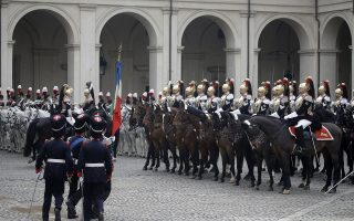 Cuirassier presidential horse guards line up at the Quirinal presidential palace in Rome, Wednesday, Jan. 14, 2015.  Italy's President Giorgio Napolitano has resigned as promised, less than two years after accepting an unprecedented second term as head of state because squabbling lawmakers couldn't agree on a successor. The Quirinal presidential palace said Napolitano, who turns 90 this year, signed his formal resignation late Wednesday morning. (AP Photo/Gregorio Borgia)