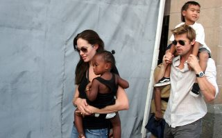 American movie star and UNHCR Ambassador Angelina Jolie, left, with her daughter Zahara, and Brad Pitt, right, with Jolie's son Maddox, walk near the Gateway of India in Mumbai, India, Sunday, Nov. 12, 2006. Jolie is in India to shoot for Michael Winterbottom's film