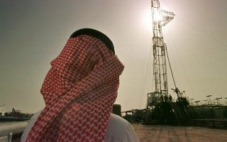 FOR USE WITH FEATURE PACKAGE FOR WEDNESDAY, APRIL 16--Khaled al Otaiby, an official of the Saudi oil company Aramco, watches progress at a rig at the al-Howta oil field near Howta, Saudi Arabia, on Feb. 26, 1997. Energy is the big strand in a web of U.S.-Saudi economic ties that has grown in the six years since an American-led army rolled back Iraqi aggression in the Persian Gulf.(AP Photo/John Moore)