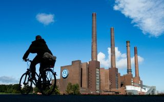 epa04944493 A cyclists makes her way past the Volkswagen plant in Wolfsburg, Germany, 23 September 2015. Volkswagen's board began a crisis meeting on 23 September that could decide the future of board chairman Martin Winterkorn, as Europe's biggest carmaker struggles to respond to a deepening emissions testing scandal. The carmaker's weekend admission that it had installed sophisticated software in its diesel models aimed at beating US exhaust tests has sent shockwaves through the German auto industry.  EPA/JULIAN STRATENSCHULTE