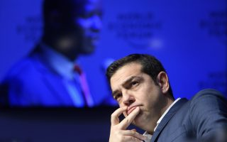 epa06470354 Greek Prime minister Alexis Tsipras attends the 48th Annual Meeting of the World Economic Forum, WEF, in Davos, Switzerland, 24 January 2018. The meeting brings together enterpreneurs, scientists, chief executive and political leaders in Davos January 23 to 26.  EPA/LAURENT GILLIERON