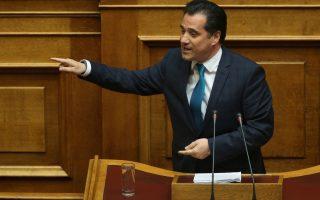 Ο αντιπρόεδρος της ΝΔ Άδωνις Γεωργιάδης μιλάει από το βήμα της Βουλής στη συζήτηση  και λήψη απόφασης, σύμφωνα με τα άρθρα 68 παρ. 2 του Συντάγματος και 144 επ. του Κανονισμού της Βουλής:  Α.  Επί της προτάσεως που κατέθεσαν ο Πρόεδρος της Κοινοβουλευτικής Ομάδας του Συνασπισμού Ριζοσπαστικής Αριστεράς κ. Αλέξης Τσίπρας και οι Βουλευτές του κόμματός του και ο Πρόεδρος της Κοινοβουλευτικής Ομάδας των Ανεξαρτήτων Ελλήνων κ. Παναγιώτης (Πάνος) Καμμένος και οι Βουλευτές του κόμματός του, για σύσταση Εξεταστικής Επιτροπής για τη διερεύνηση σκανδάλων στον χώρο της Υγείας κατά τα έτη 1997-2014,  και Β. Επί της προτάσεως που κατέθεσε ο Αρχηγός της Αξιωματικής Αντιπολίτευσης και Πρόεδρος της Κοινοβουλευτικής Ομάδας της Νέας Δημοκρατίας κ. Κυριάκος Μητσοτάκης και οι Βουλευτές του κόμματός του, για σύσταση Εξεταστικής Επιτροπής  για τη διερεύνηση της διαχείρισης και των δαπανών της δημόσιας υγείας από το 1996 μέχρι σήμερα, Μεγάλη Τετάρτη 12 Απριλίου 2017. ΑΠΕ-ΜΠΕ/ΑΠΕ-ΜΠΕ/ΑΛΕΞΑΝΔΡΟΣ ΒΛΑΧΟΣ