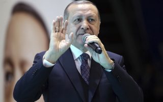 Turkey's President and leader of ruling Justice and Development Party Recep Tayyip Erdogan addresses the party members in Afyonkarahisar, Turkey, Saturday, Feb. 17, 2018. (Kayhan Ozer/Pool Photo via AP )