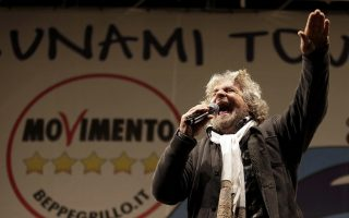 Five Star Movement leader and comedian Beppe Grillo (R) speaks during a rally in Rome in this February 22, 2013 file photograph. To match Special Report ITALY-MPS/ 