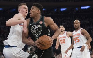 Milwaukee Bucks forward Giannis Antetokounmpo (34) drives to the basket against New York Knicks forward Kristaps Porzingis, left, during the first half of an NBA basketball game Tuesday, Feb. 6, 2018, at Madison Square Garden in New York. (AP Photo/Mary Altaffer)