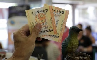 epa06156890 A man shows his Powerball lottery tickets at the Bluebird Liquor store in Hawthorne, California, USA, 22 August 2017.  The Powerball lottery has risen to 700 million US dollars making it one of the largest in history.  The drawing will take place 23 August 2017.  EPA/MIKE NELSON