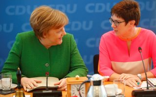 German Chancellor Angela Merkel and Saarland State Prime Minister Annegret Kramp-Karrenbauer ahead CDU leadership meeting in Berlin, Germany, February 19, 2018.    REUTERS/Hannibal Hanschke