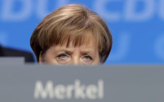 German Chancellor and party chairwoman Angela Merkel listens to the debate during the party convention of the Christian Democratic Union CDU in Berlin, Germany, Monday, Feb. 26, 2018. The delegates came together to decide on the coalition agreement on forming a new German government. (AP Photo/Markus Schreiber)
