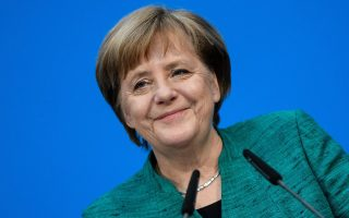 epa06502947 German Chancellor and Chairwoman of the Christian Democratic Union (CDU), Angela Merkel, grimaces during a press conference following coalition talks held at the CDU headquarters Konrad-Adenauer-Haus, in Berlin, Germany, 07 February 2018. The leaders of the Christian Democratic Union of Germany (CDU), the Christian Social Union (CSU) from Bavaria and Social Democratic Party (SPD) have been conducting coalition talks to form a new government, four months after the general election in September 2017.  EPA/CLEMENS BILAN