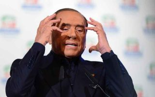 Italian leader of the Forza Italia centre-right party Silvio Berlusconi gestures as he speaks during a pre-election gathering in Milan, Italy February 25, 2018. REUTERS/Massimo Pinca